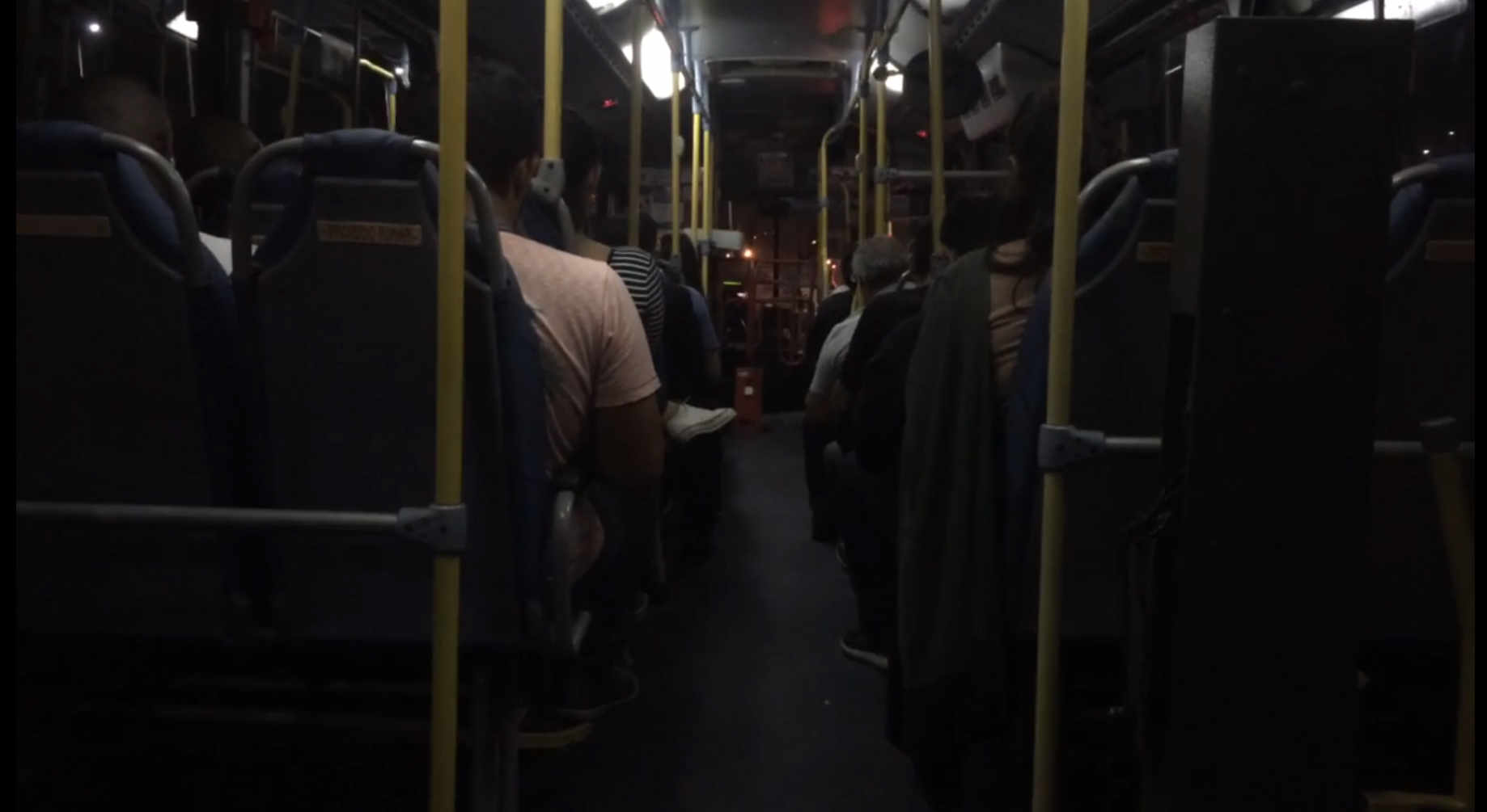 image of a bus with people at night